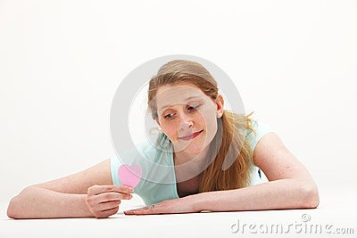 Wistful woman looking at Valentines heart