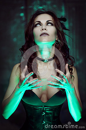 Free Witch Creates Magic. Beautiful And Sexy Woman With A Mystical Light Stock Images - 77296954