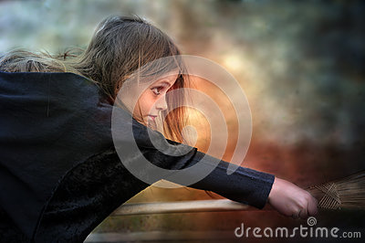 Witch flying on broom Stock Photo