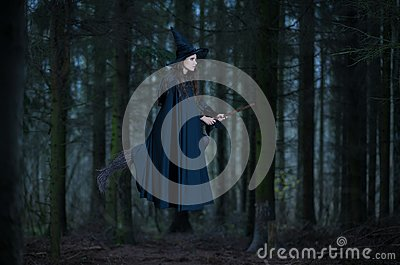 Witch flying on a broom Stock Photo