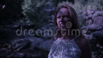Witch in forest at night. Vampire Rocks. ghost. Fantasy and gothic. halloween stock video footage