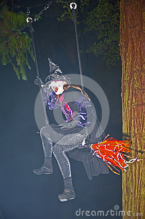 Witch on her broomstick Editorial Photo