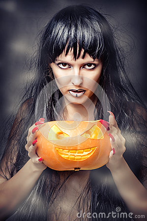 Free Witch Holding Pumpkin Royalty Free Stock Photos - 26345148