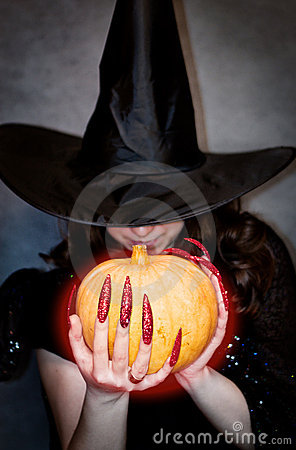 Witch with pumpkin in hands