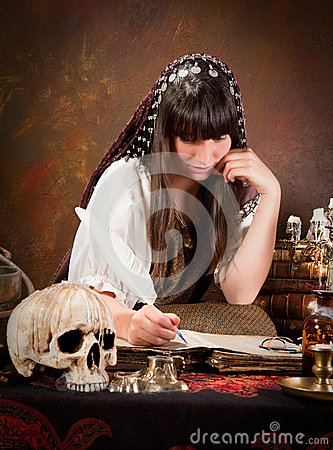 Witch writing in the book of shadows