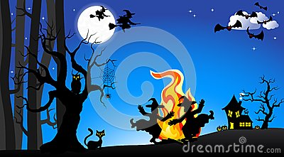 Witches dancing around fire at halloween