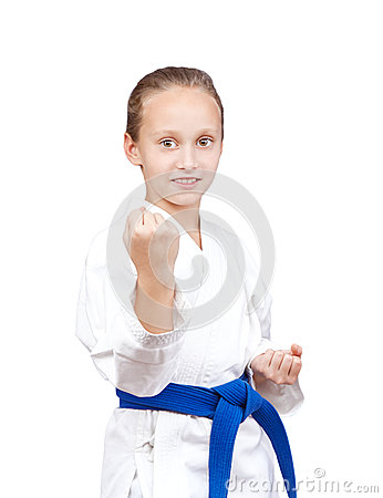 Free With Blue Belt Sportswoman Is Standing In Rack Of Karate Stock Photos - 61796123