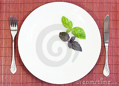 Witte plaat met vork en mes