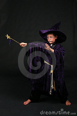 Wizard boy with magic wand casting a spell