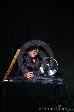 Wizard child with crystal ball and staff