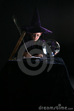 Wizard child writing a spell