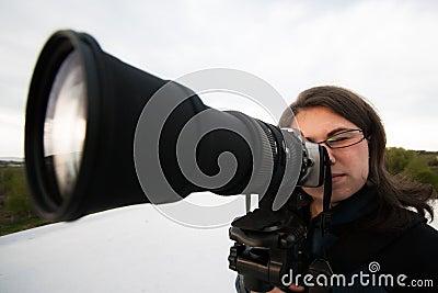 Żeński fotograf