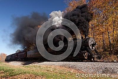 WM Steam train powers along railway Editorial Image