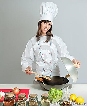 Wok que cozinha a lição