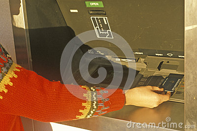 Woman at 24 hour ATM machine Editorial Image