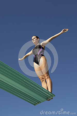 Free Woman About To Dive Backwards Off A Diving Board Stock Photos - 30842343