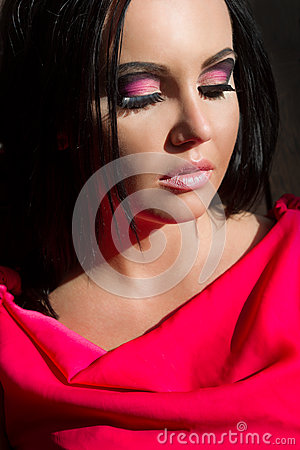 Woman with abstract pink make-up