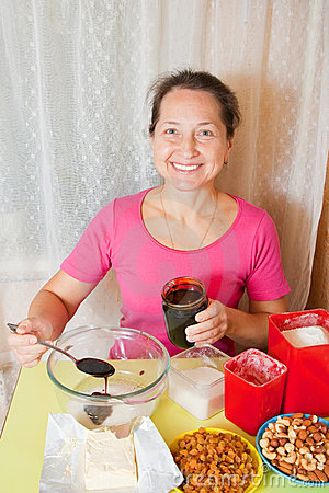 Woman adds honey into dish with sugar