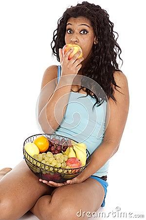 Woman African American basket fruit bite apple