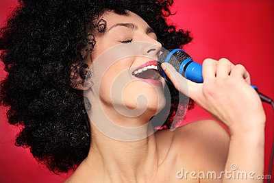 Woman with afro hairstyle singing