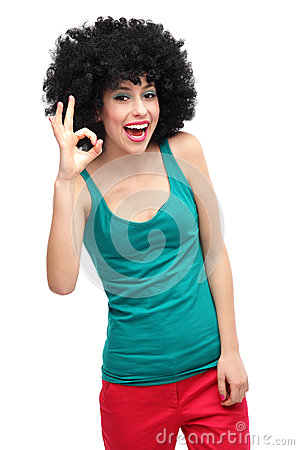 Woman with afro showing OK sign