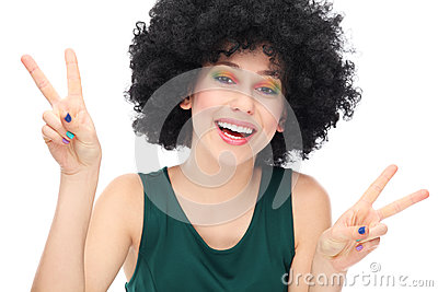 Woman with afro showing peace sign