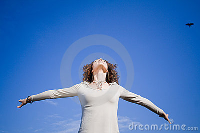 Woman against blue sky