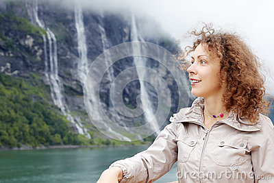 Woman against Seven Sisters Waterfall