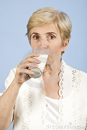 Woman aged drinking milk