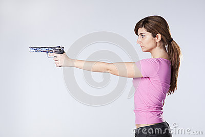 Woman aiming a handgun