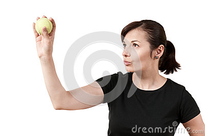 Woman aiming with a tennis ball