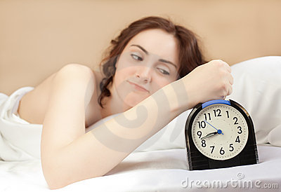 Woman and an alarm (focus on alarm)