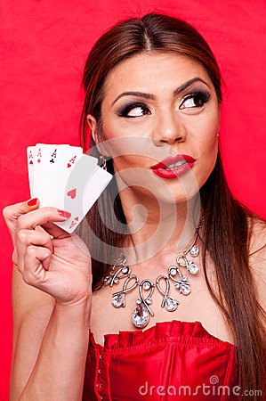 Woman with all aces in her hand
