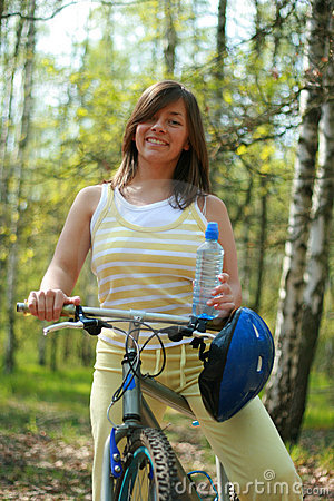 Free Woman And Bike Royalty Free Stock Photography - 2321577