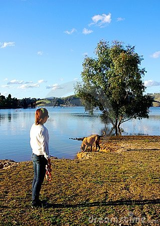 Free Woman And Dog At Lake Eildon Royalty Free Stock Photography - 23977477
