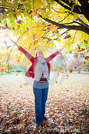 Free Woman And Falling Leaves Stock Photos - 27515523