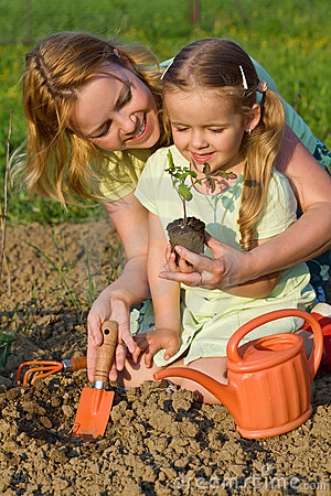 Free Woman And Little Girl Growing Healthy Food Stock Images - 14178494