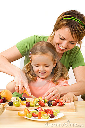 Free Woman And Little Girl Preparing Fruit Salad Stock Images - 9839934