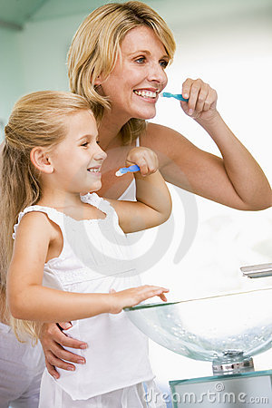 Free Woman And Young Girl In Bathroom Brushing Teeth Stock Photos - 5774803