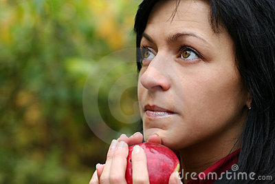 Woman and apple in autumn park