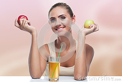 Woman with apple juice on autmn color background