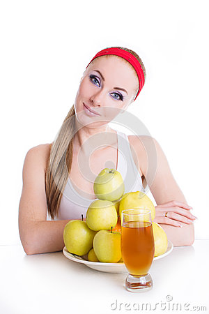 Woman with apple juice and fruits