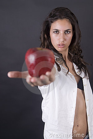 Woman with apple and money in a temptation
