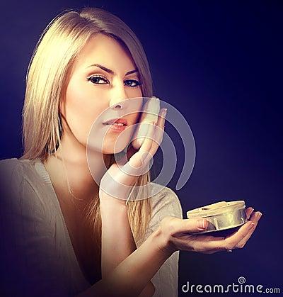 Woman apply cosmetic sponge