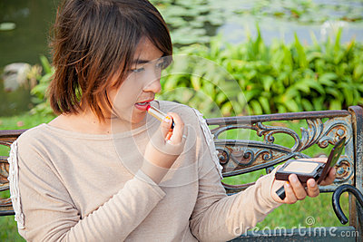 Woman apply lip