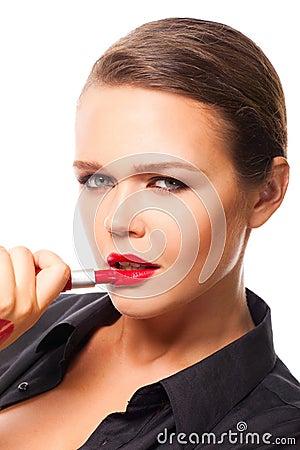 Woman apply lipstick