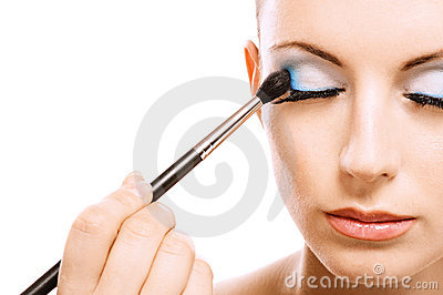 Woman applying blusher eyelid