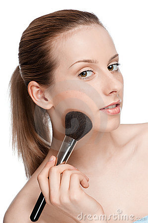 Woman applying cosmetic brush