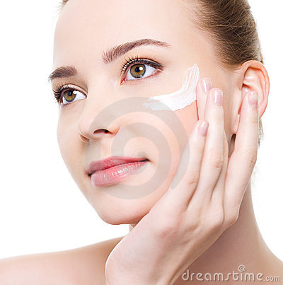 Woman applying cosmetic near eyes