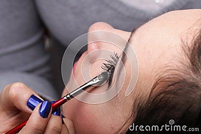Woman applying eyeshadow makeup brush